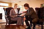 Business people talking in hotel lobby
