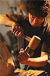 Sculptor carving wood
