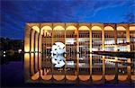 South America, Brazil, Brasilia, Distrito Federal, night view of Oscar Niemeyers Palacio de Itamaraty in Brasilia, reflected in the surrounding lake landscaped by Roberto Burle Marx