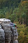 Czech Republic, Bohemia, Prahovskie Region, A mountain climber on one of the hills at the Prahovskie Skali nature reseve. Unesco tentative list