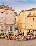 France, Provence, Avignon, Place de Palais, Tourists at cafe