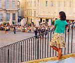 France, Provence, Avignon, Place de Palais, Woman looking over square MR