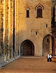France, Provence, Avignon, Palais de Papes, Two nuns walking down cobbled road