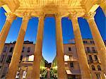 France, Provence, Nimes, Maison Caree, View through pillars at night