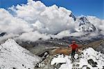 Asia, Nepal, Himalayas, Sagarmatha National Park, Solu Khumbu Everest Region, Mt Everest, 8850m, trekker climbing Chukhung Ri. MR