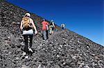 Tourist trekking up Volcan Cerro Negro, Leon, Nicaragua, Central America