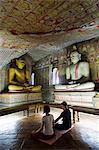 Sri Lanka, North Central Province, Dambulla, Golden Temple. , UNESCO World Heritage Site, Royal Rock Temple, Buddha statues in Cave 2, couple meditating