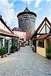 Quaint Shops in Handwerkerhof with Historic City Tower, Nuremberg, Middle Franconia, Bavaria, Germany