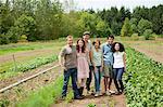 Group of people in vegetable field on farm