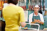 Fishmonger and customer in supermarket