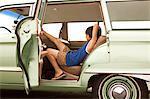 Sullen boy sitting in car