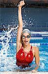Female swimmer winning race