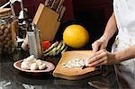 Woman chopping mushrooms