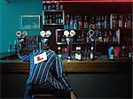 Man asleep at bar