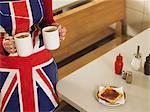 Waitress bringing mugs of tea