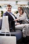 Senior couple looking into a shopping bag at mall