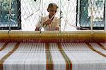 A woman working at a loom weaving textile, Beruwala, Sri Lanka, Asia