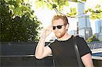 Man wearing sunglasses on city street