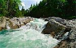 Rocky river in rural landscape