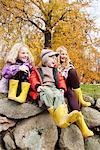 Children wearing rain boots outdoors