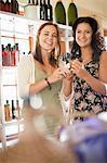 Women holding vinegar bottle in grocery