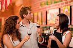 Server and customers tasting wine