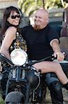 Couple sitting on motorcycle