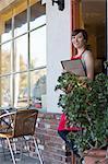 Waitress standing at cafe door