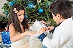 Children opening Christmas present