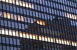 Illuminated windows of skyscraper
