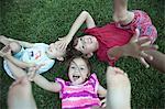 Children playing in grassy field