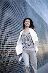 Smiling businesswoman walking outdoors