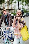 Woman fastening bicycle helmet