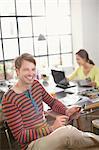 Smiling man using digital tablet