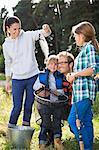 Family admiring fishing catch