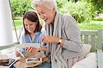 Woman and granddaughter looking at photos