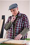 Man Measuring Lumber, Woodworking Project, in Studio