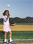 A girl throwing a baseball