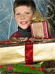 Boy holding presents