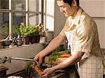 Man washing carrots