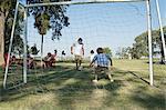 Dad and boys playing football