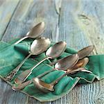 Assorted Silver Spoons on Felt Cloth