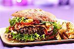A bacon hamburger with chips