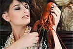 Woman tearing lobster apart