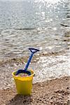 Shovel and bucket on the shore, Okanagan Valley, British Columbia, Canada