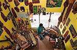 South America, Brazil, Amazonas state, Manaus, sculptor James Alcantara of the stdio J Alcantara Arte em Madeira, carving a wooden jaguar in the family atelier in the Central de Artesanato Branco e Silva