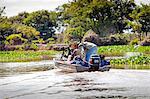 South America, Brazil, Mato Grosso, Pantanal, a wildlife photographer looking for jaguar in the Parque Estadual Encontro das Aguas
