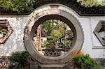 China, Yunnan, Tonghai. Moon gate at the Taoist temple gardens in Xiushan Mountain Park in Tonghai.