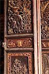 China, Yunnan, Jianshui. Ornate wooden doors at the Confucian Temple at Jianshui.