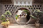 China, Yunnan, Jianshui. A moon gate at the Zhu Family Garden Hotel, an old Chinese mansion dating back to the Qing Dynasty, in Jianshui.